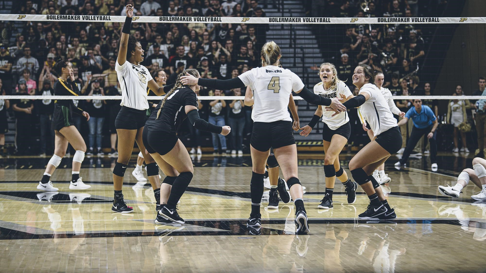 Members of the Purdue volleyball team during a game